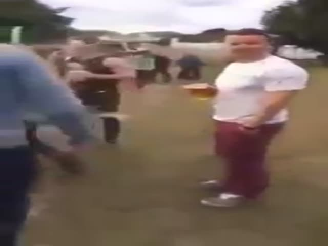 Drunk Guy Does a Nasty Tackle to Another Drunk Guy