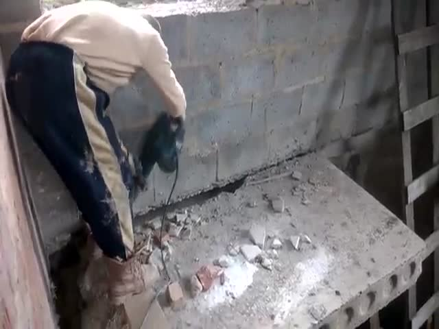 Stupid Demolition Worker Destroys the Platform He's Standing On  (VIDEO)