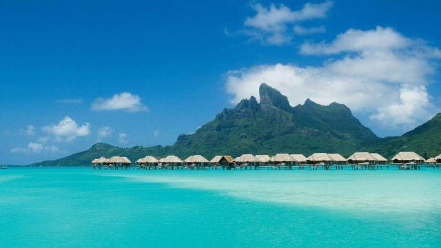 I Would Rather Be in Bora Bora Now Than at My Work Desk