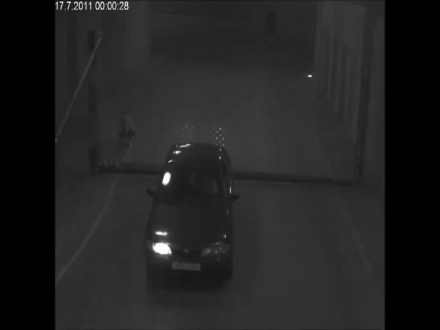 Man Takes On Parking Security Gate, Loses!