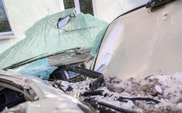 High Rise Building Panel Falls on a Parked Car