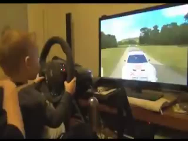 Toddler Plays Rally Video Game like a Pro