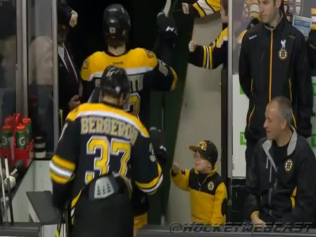 Adorable Boston Bruins Fan Fist Bumps the Whole Team  (VIDEO)
