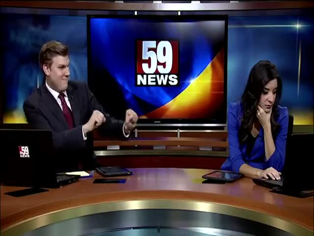 News Anchor Dances during Commercial Breaks, His Co-Anchor Is Not Impressed!