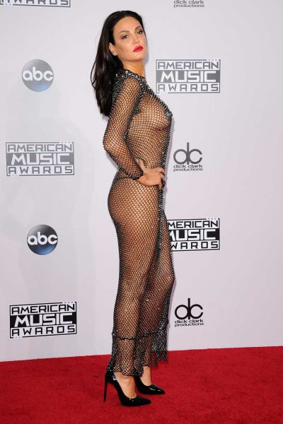Albanian Singer Arrives at AMA's Wearing Almost Nothing