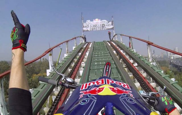 Daredevil Rides Motorcycle on Roller Coaster tracks