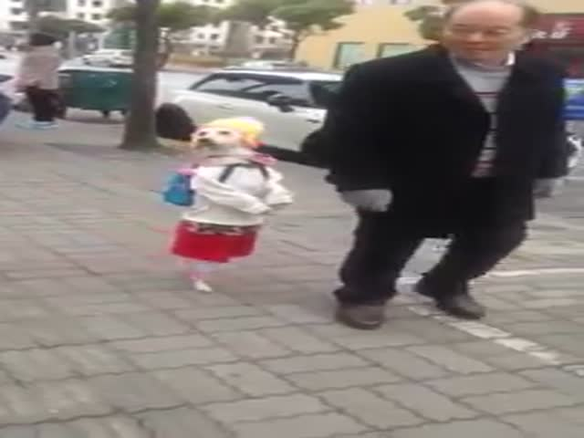 Meanwhile, in China: Man Walks His 'Little Girl' Down the Street  (VIDEO)