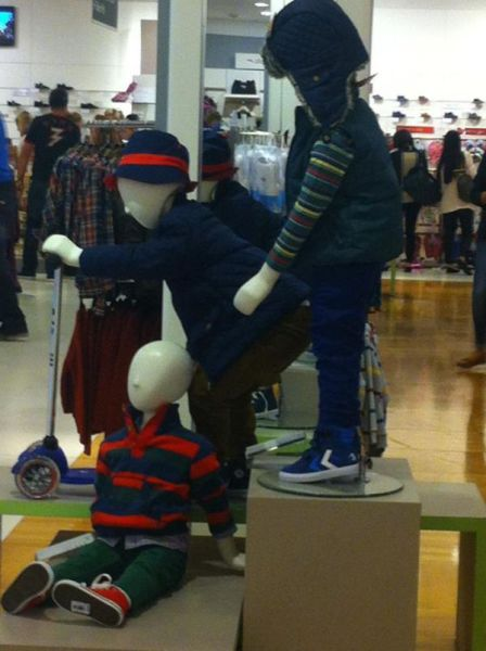 Mannequins Looking Precarious