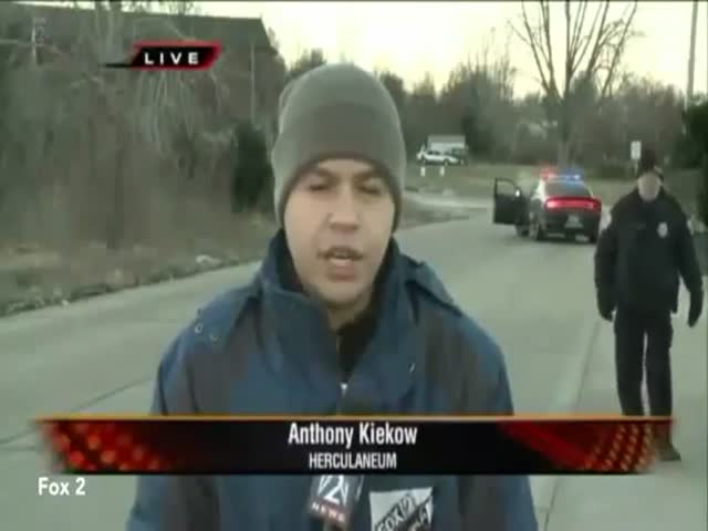 Police Officer's Funny Reaction When Realizing He's on Live TV