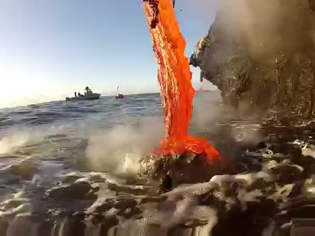 Close-Up of Lava Spilling into the Ocean  (VIDEO)