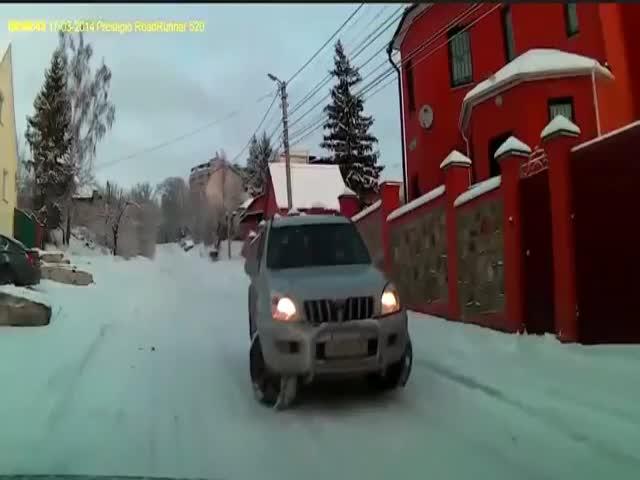Car Driver Does a Great Job at Avoiding Sliding Car  (VIDEO)