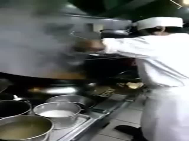 Cooking in a Huge Wok for 60 Persons