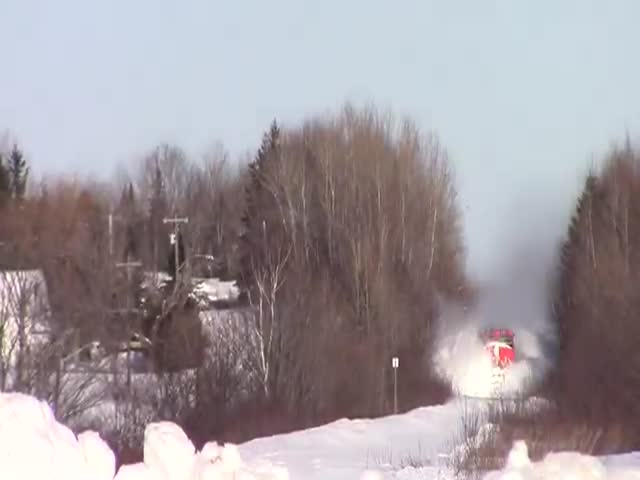 Train Plows through Massive Snow Bank