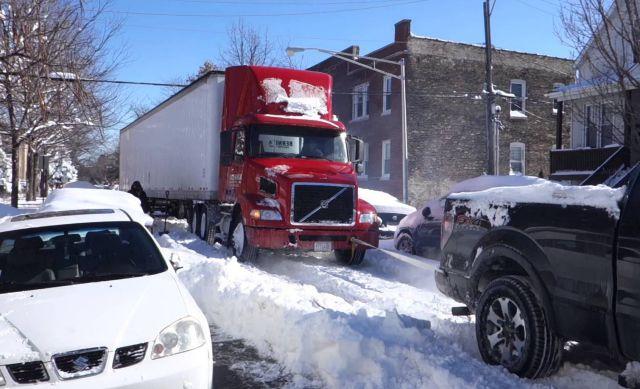 Pickup Truck Tows Semi-Truck Stuck in Snow