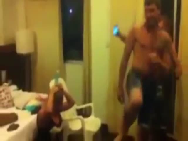 Guy Tries to Kick a Bottle Off His Girlfriend's Head  (VIDEO)