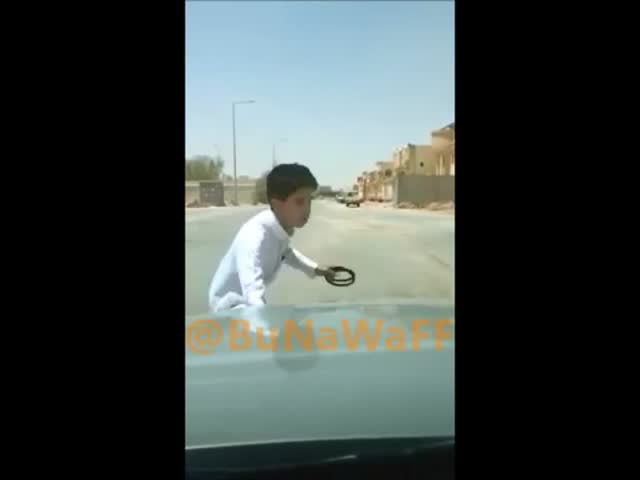 Saudi Kid Locks Himself Out of a Moving Car