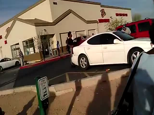 Parking Lot Altercation Quickly Escalates  (VIDEO)