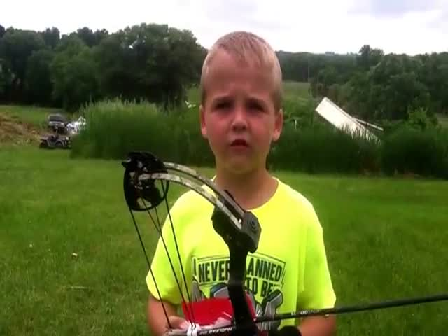 Kid Archer Fires an Incredible Over-the-shoulder Shot  (VIDEO)