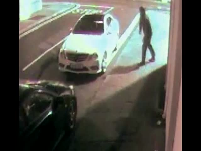 Car Thief Throws Brick at Window, Gets Instant Karma