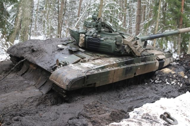 Mud Stops Polish Army Tanks in Their Tracks