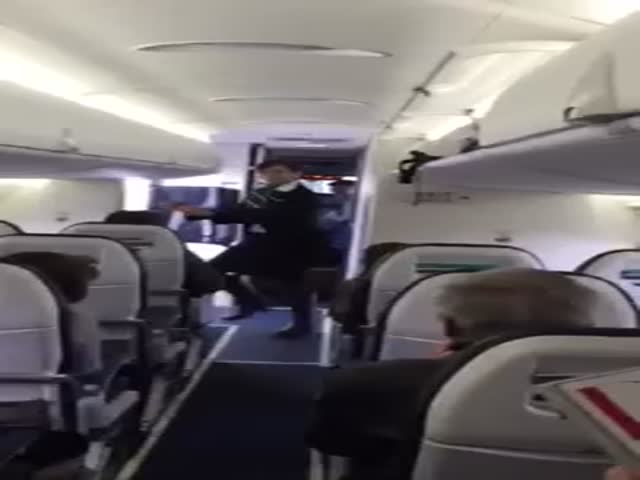 Flight Attendant Dances to 'Uptown Funk'