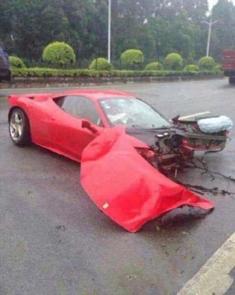 A Ferrari Takes on a Tree and Loses Horribly