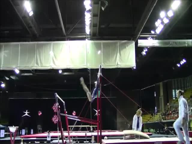 Awesome Coach Catches Falling Gymnast Twice  (VIDEO)