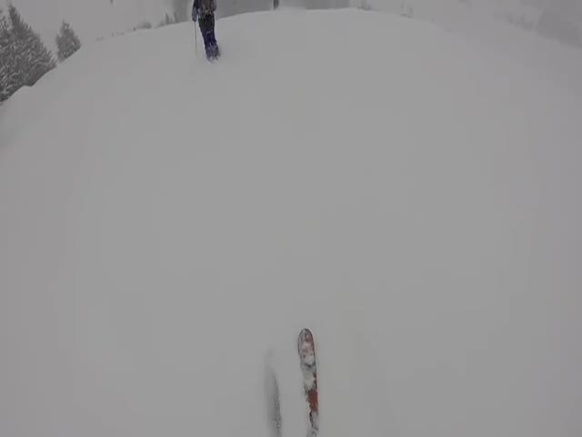 Terrifying Footage Shows Skiers Rescuing Friend Buried under Snow Barely in Time