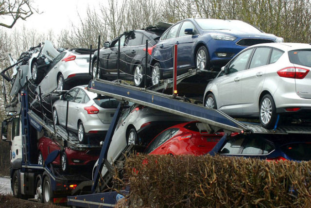 A Bridge Collision Squashes a Trailer Full of New Cars