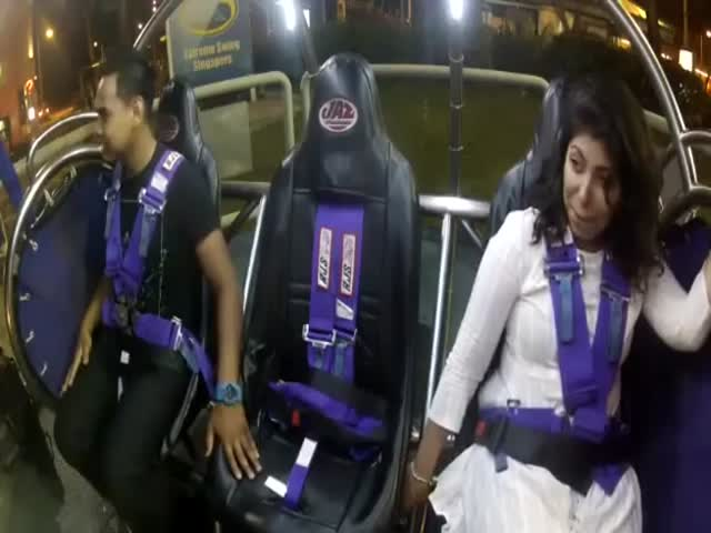 Possessed Man on Slingshot Ride in Singapore