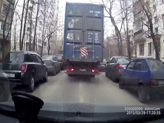 Truck Takes Turn Wrong and Catches Unwanted Passenger  (VIDEO)
