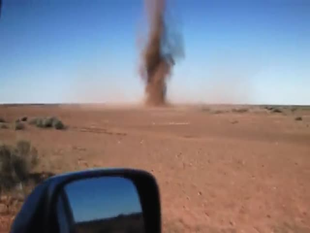 Dude Runs into a Dust Devil  (VIDEO)