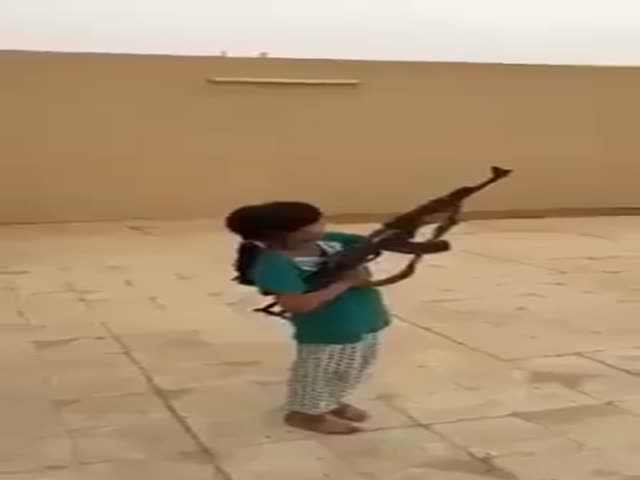 Stupid Adults Give a 10-Year-Old Girl a Loaded AK-47