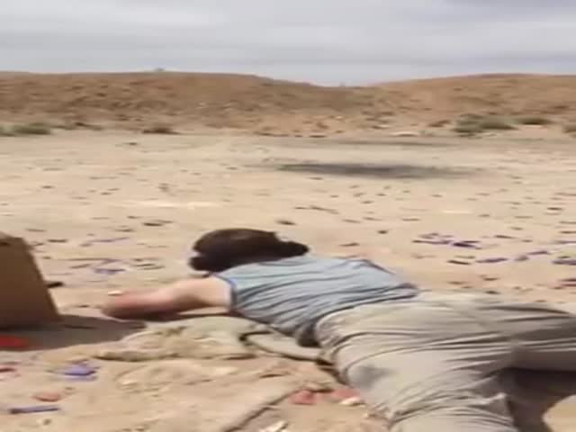 Guy Shoots Explosive in the Desert and Is Almost Hit by Some Flying Debris