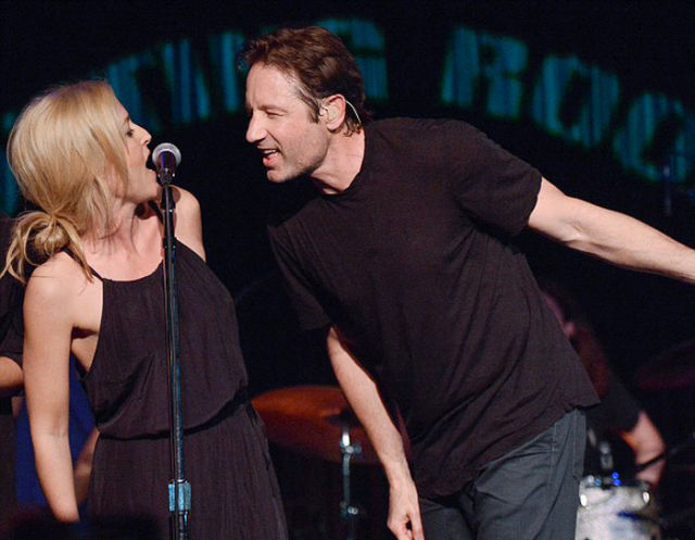 Former X-Files Co-stars Share a Sweet Kiss on Stage