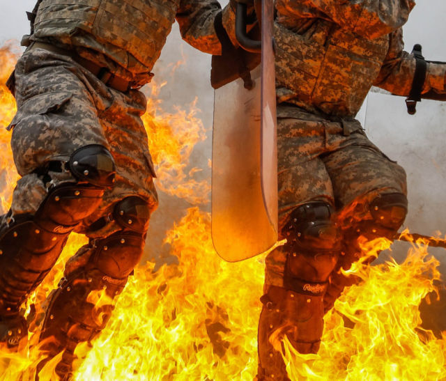 Military Units Brave a Full Fire Attack in Training