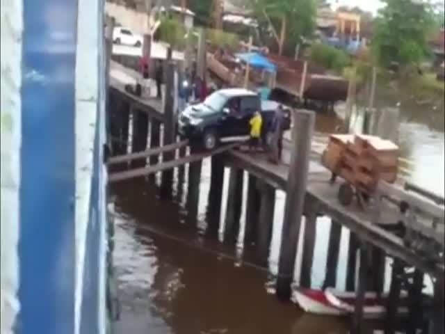 Meanwhile, in Brazil: Loading a Car onto a Ship Using Planks