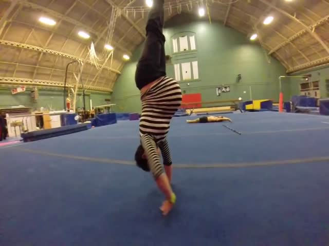 Pregnancy Didn't Stop This Pro Gymnast from Doing Handstands  (VIDEO)