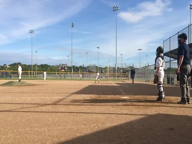 Son's Helmut Shoots a Flying Baseball at His Unsuspecting Dad  (VIDEO)