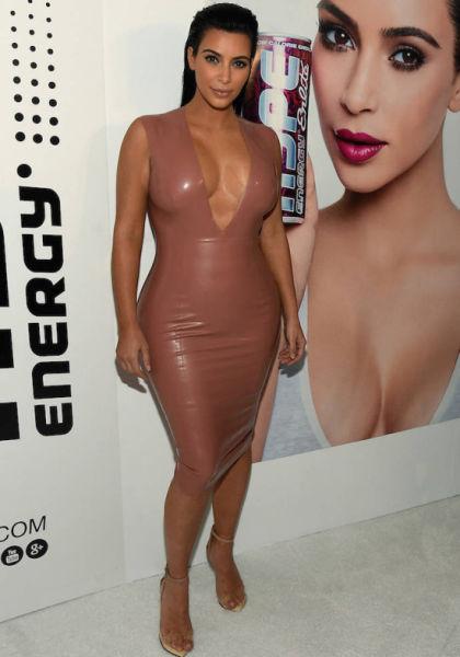 Kim Kardashian Looks Sleek in Latex for the Races