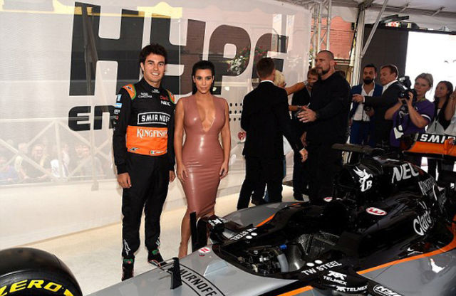Kim Kardashian Looks Sleek in Latex for the Races