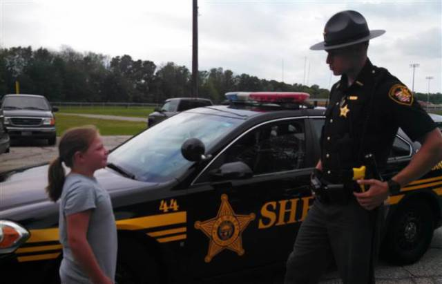 Caring Police Officer Supports a Young Girl with a Dream