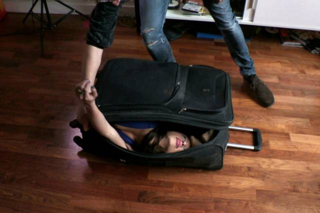 The Girl Who Is So Bendy She Can Pack Her Whole Body into a Handheld Suitcase