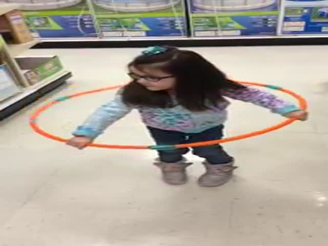 Little Girl Tries to Hula Hoop