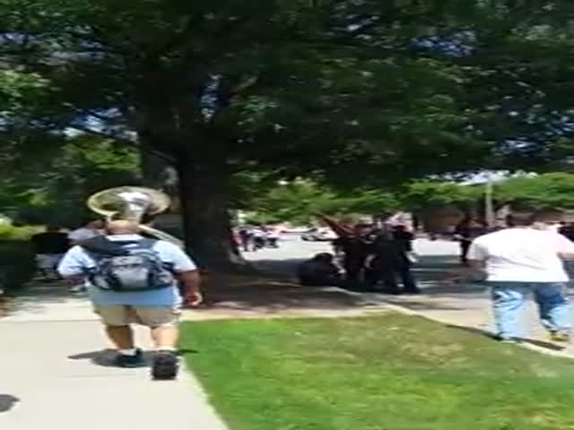 Anti-KKK Protestors March through Town Playing a Tuba for Extra Effect