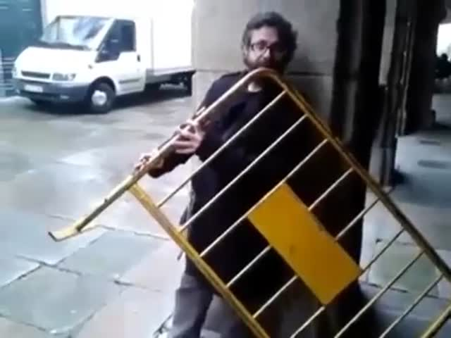 Insane Musician Turns a Normal Metal Fence into a Giant Flute