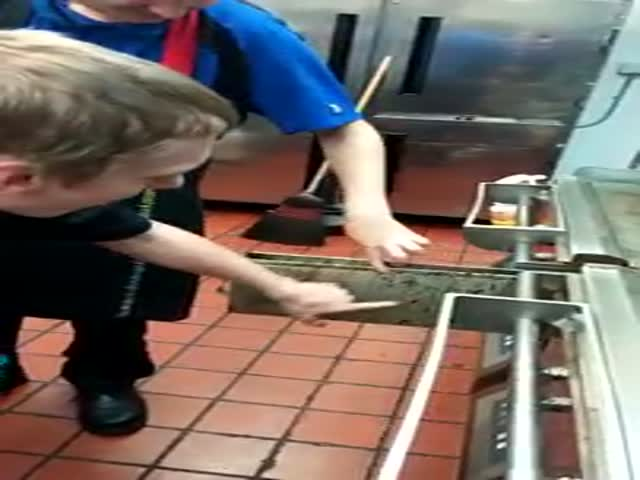 McDonald's Employee Licks a Grease Rack for $5
