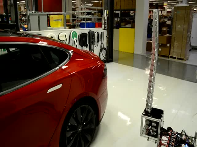 Tesla Model S Fitted with Cool New Charger Prototype