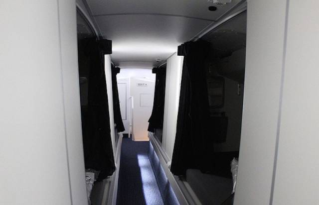 Inside the Airplane Bedrooms Where Flight Attendants Sleep on Long Flights
