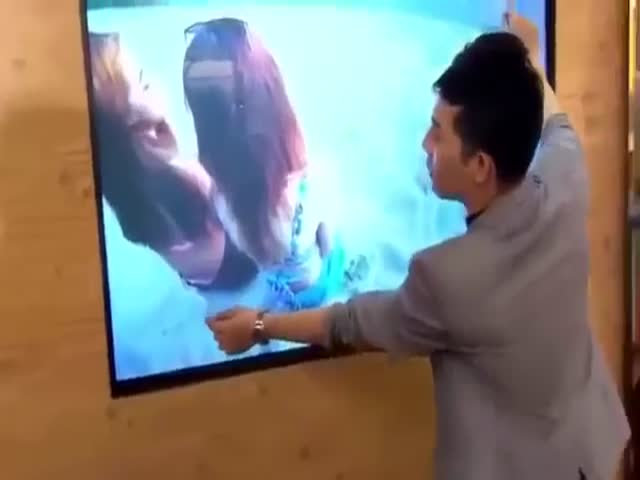 Magician Performs a Trick with a TV That You Have to See to Believe